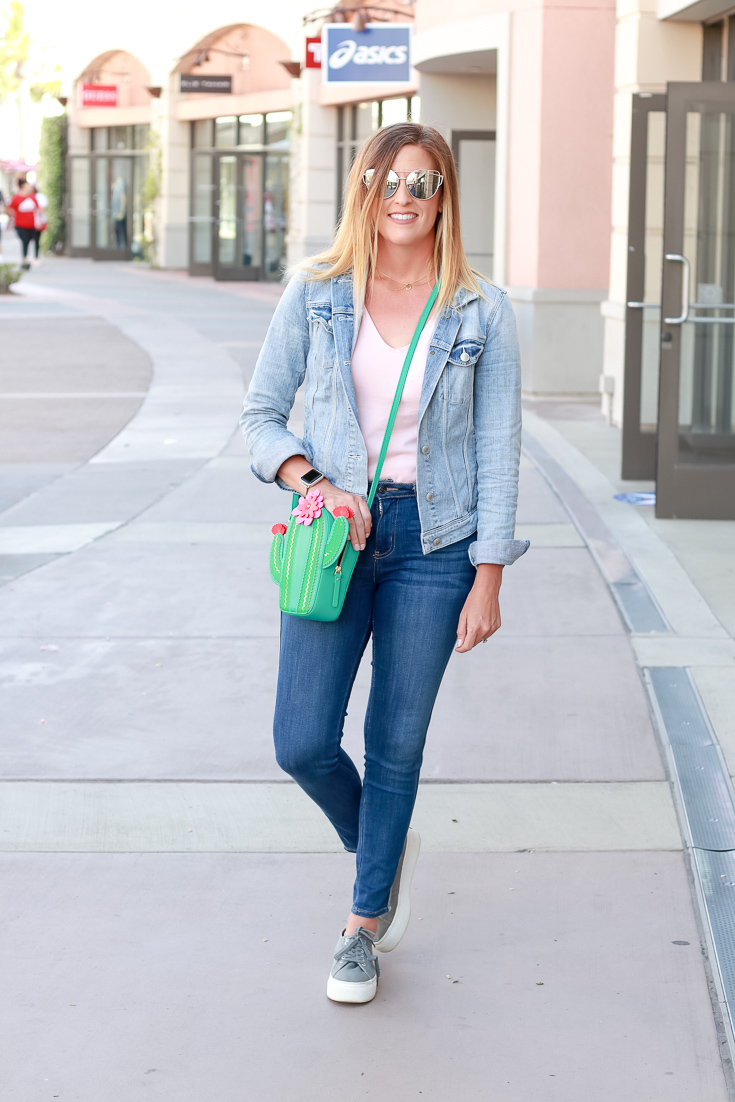 The Fashionista Momma styles a bodysuit with a cactus purse.
