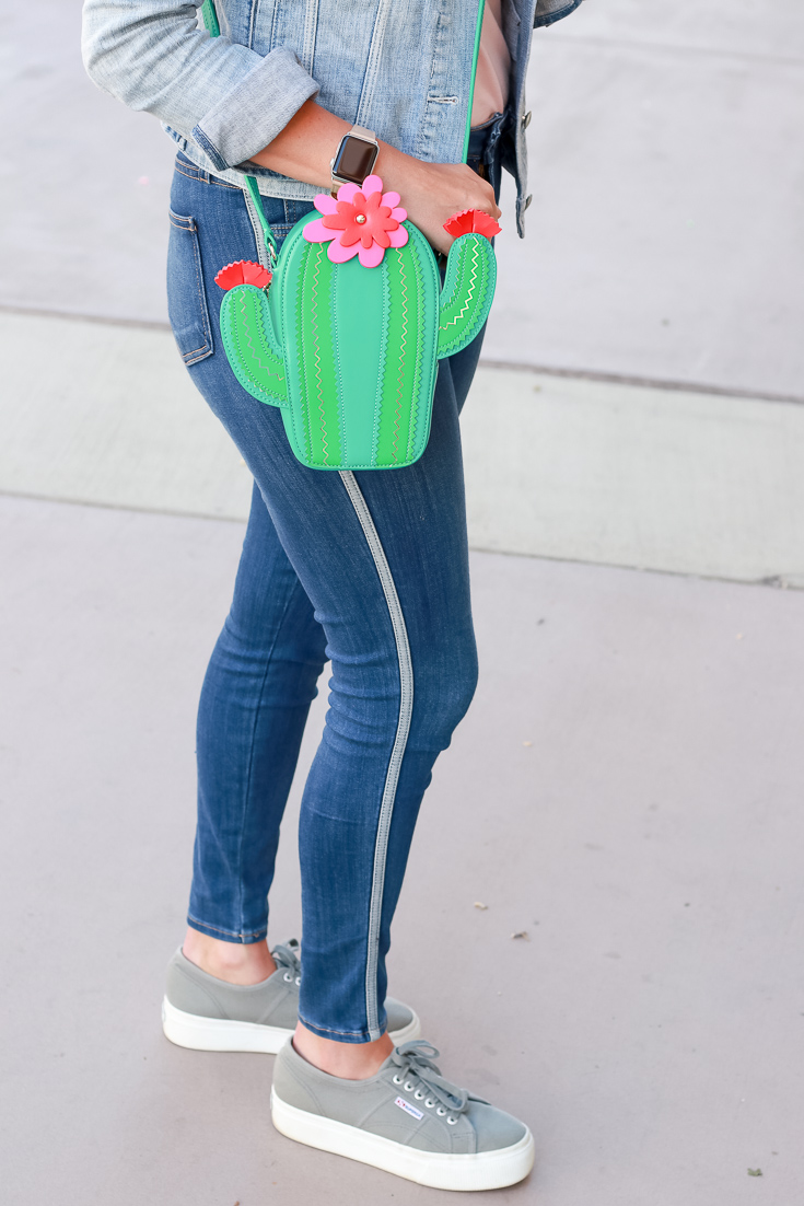 The Fashionista Momma styles a cactus purse and just black jeans.