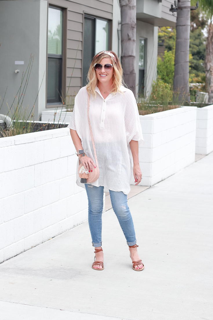 The Fashionista Momma shares a shirt dress with sandals and jeans.