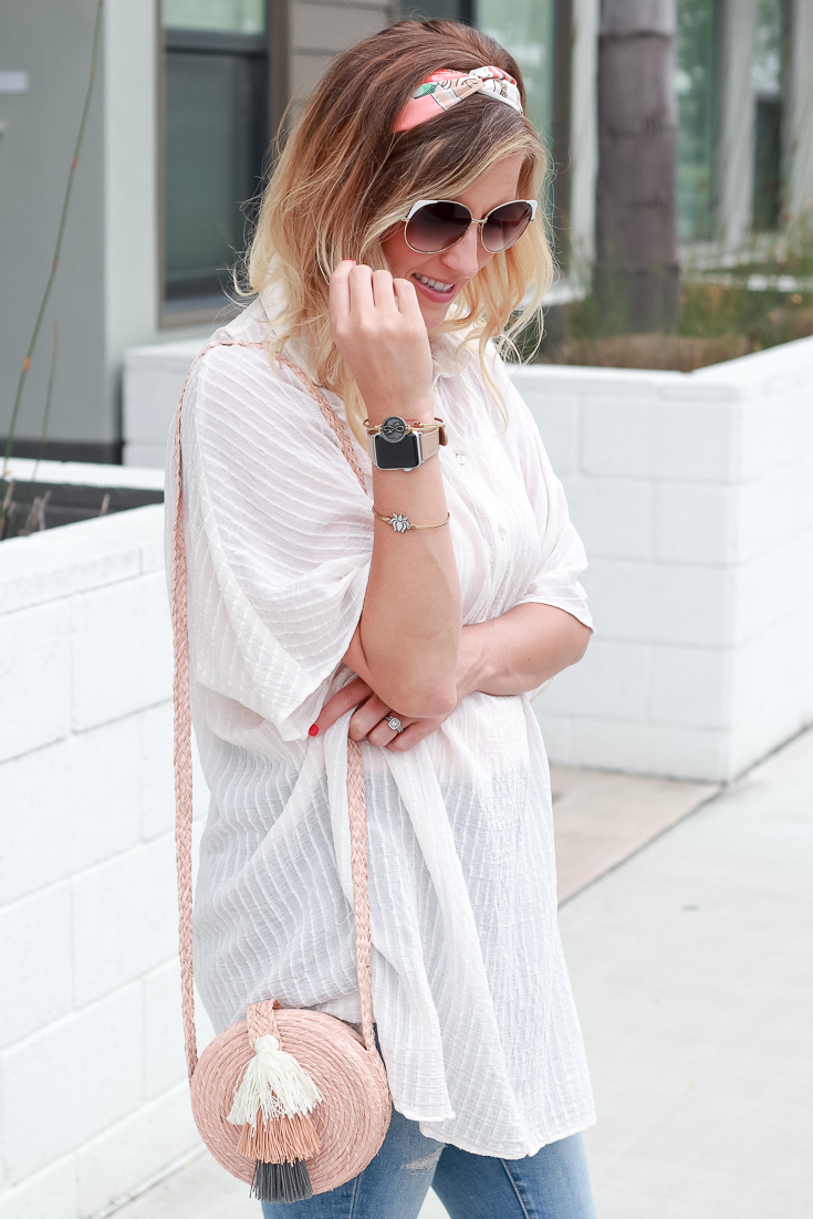 The Fashionista Momma shares a collared shirt dress with sandals and jeans.
