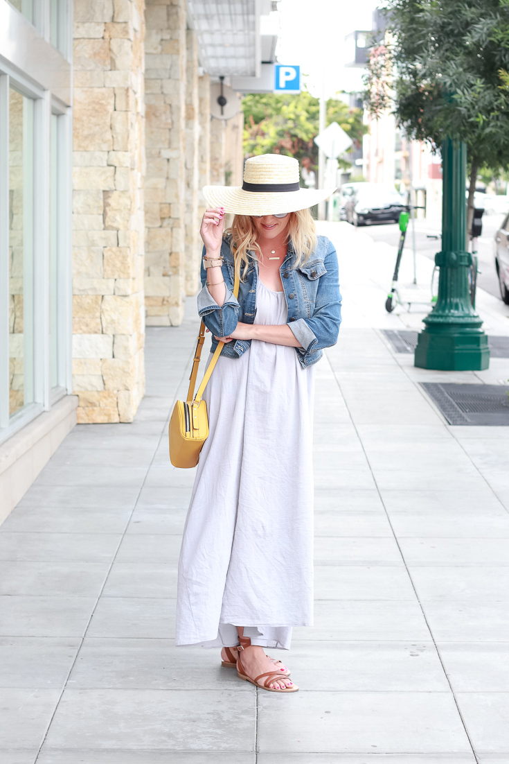 The Fashionista Momma styles a gray maxi dress, denim jacket and sandals.