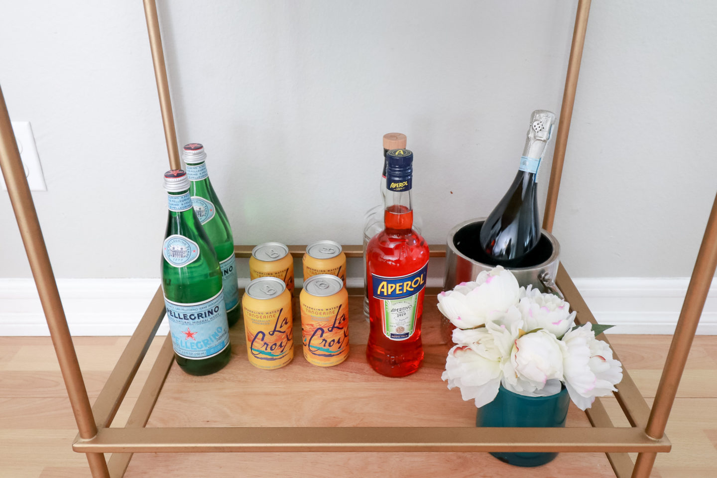 The Fashionista Momma styles a summer bar cart to host all of your summer parties.