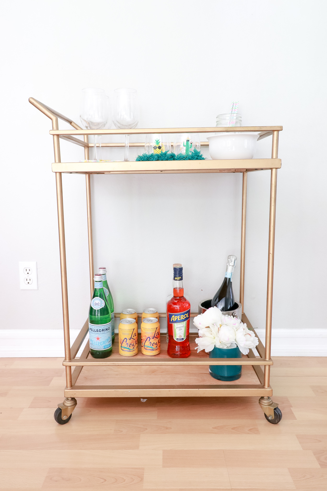 The Fashionista Momma styles a summer bar cart to host all of your summer parties with Aperol Spritz.