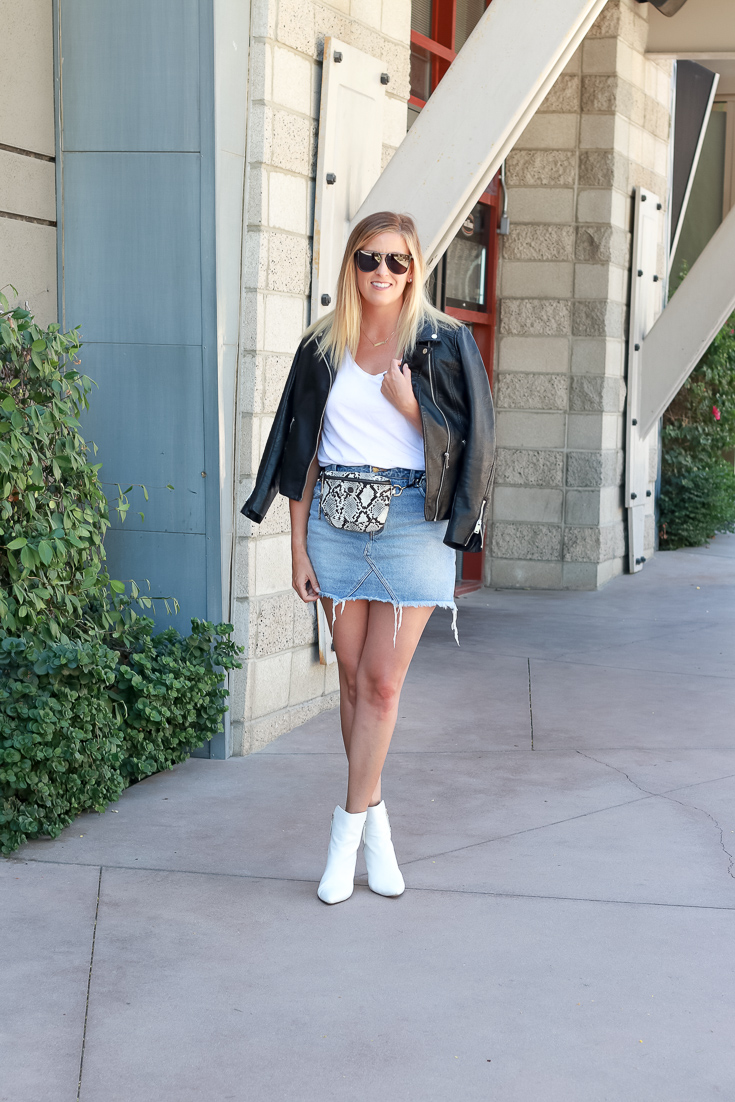 The perfect denim mini skirt with a fanny pack and leather jacket.