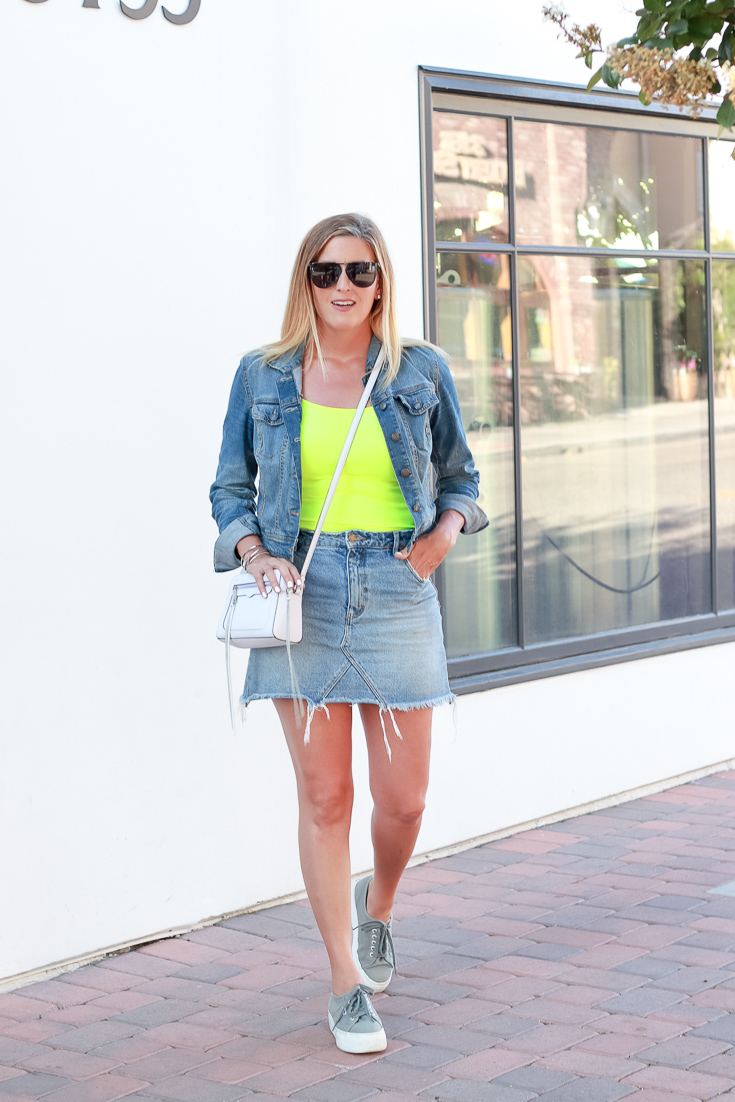 The perfect denim on denim look with a pop of neon and a denim skirt.