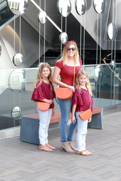 Mommy And Me Purses by Popular US fashion blogger, The Fashionista Momma : image of mom and girls in matching outfits