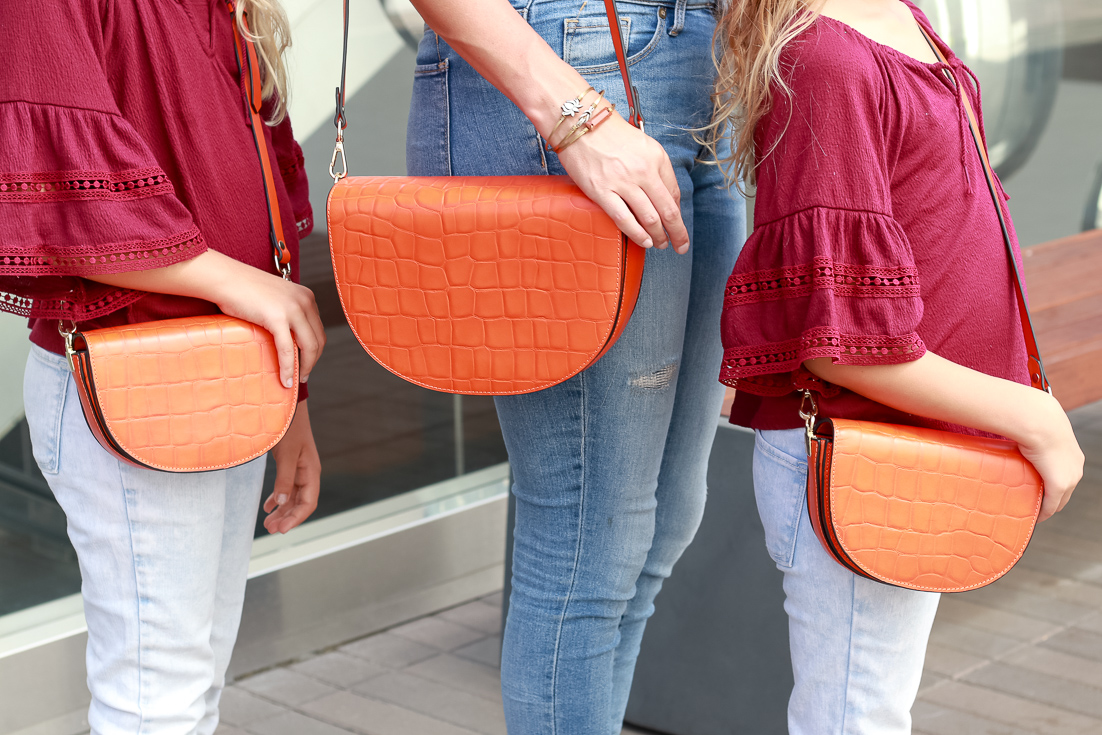 Mommy And Me Purses by Popular US fashion blogger, The Fashionista Momma  : image of mommy and me Zenko Orange Leather Shoulder Bags.