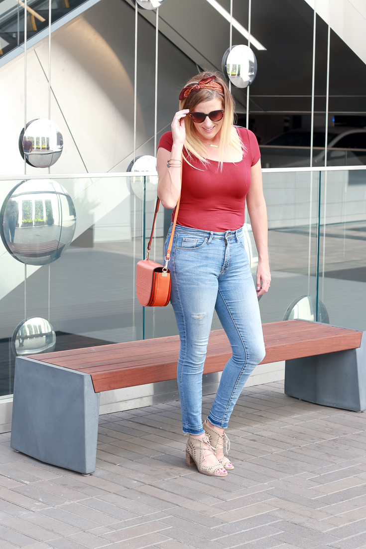 Mommy And Me Purses by Popular US fashion blogger, The Fashionista Momma  : image of blonde woman in jeans and orange purse