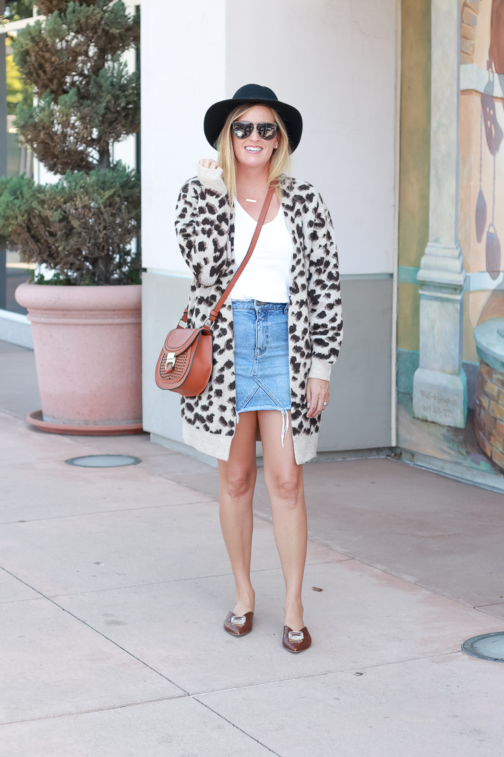 Fall Trends: Leopard Print Cardigan Roundup featured by Popular US Style Blogger, The Fashionista Momma; woman wearing cardigan denim skirt and mules.
