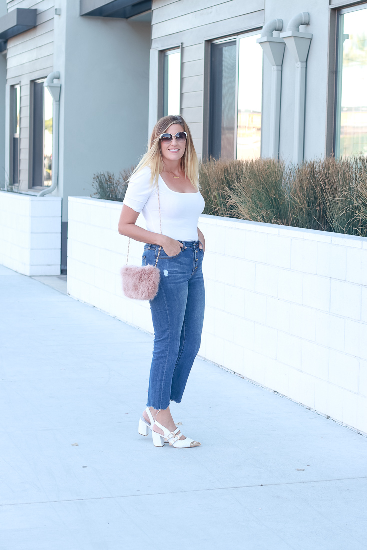 How to style your white shoes this fall featured by top US style blogger, The Fashionista Momma; blonde woman wearing cropped denim and white heels