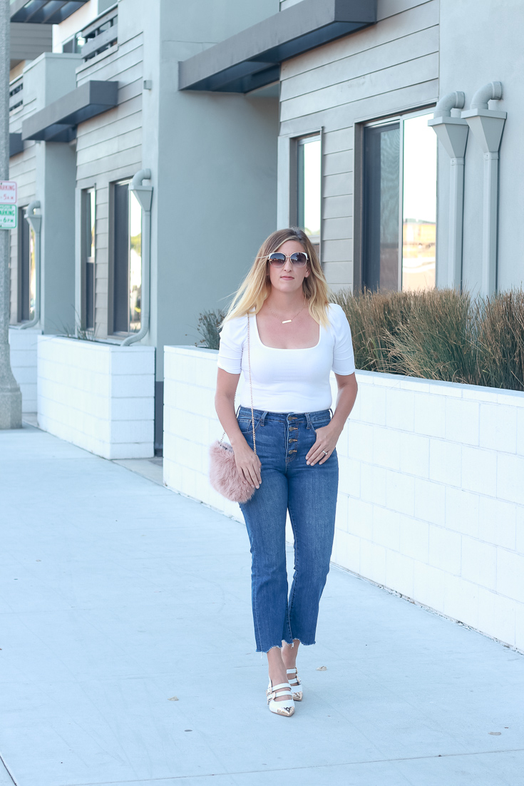 How to style your white shoes this fall featured by top US style blogger, The Fashionista Momma; blonde woman wearing cropped denim and white shoes.