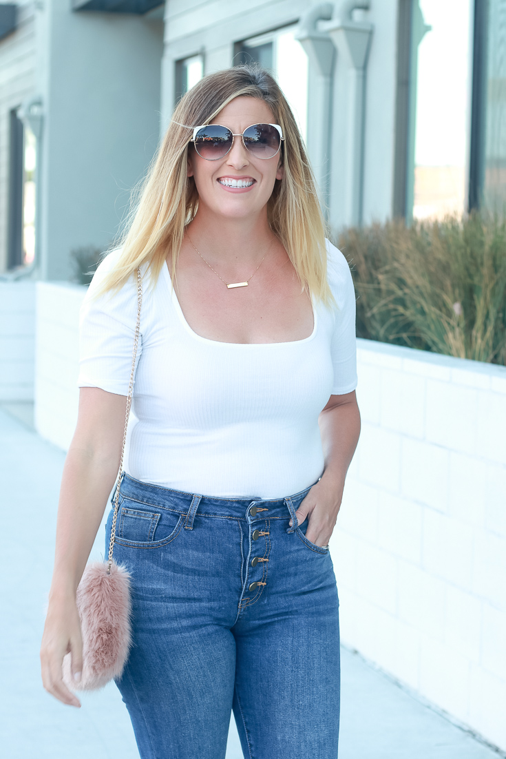 How to style your white shoes this fall featured by top US style blogger, The Fashionista Momma; blonde woman wearing a princess sleeve top and jeans