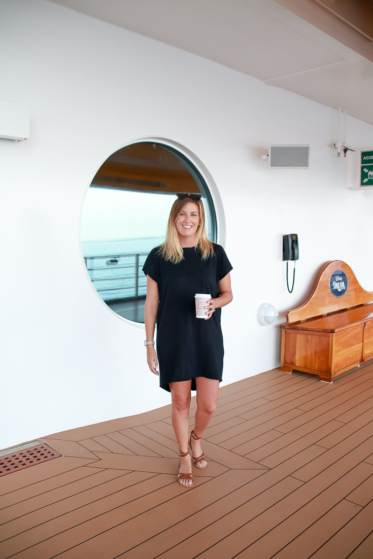 The Ultimate Disney Cruise Guide featured by Top US travel blog, The Fashionista Momma; mom in black shirt dress
