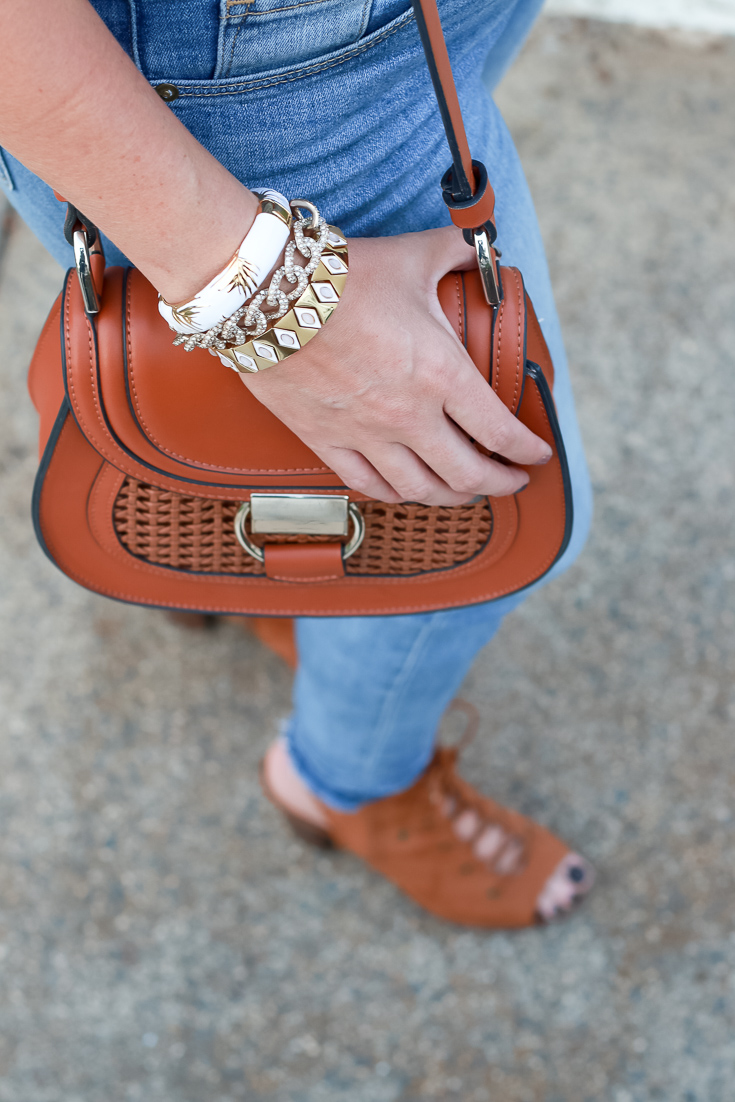 How To Style A Puff Sleeve Top by Popular US Style Blogger The Fashionista Momma; purse and bracelet stack close up