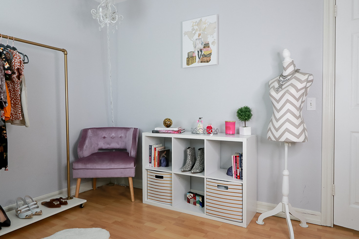 Stylish Blogger Home Office Ideas for the Fashion Influencer featured by top US Style Blogger, The Fashionista Momma; Corner space with purple chair and shelves