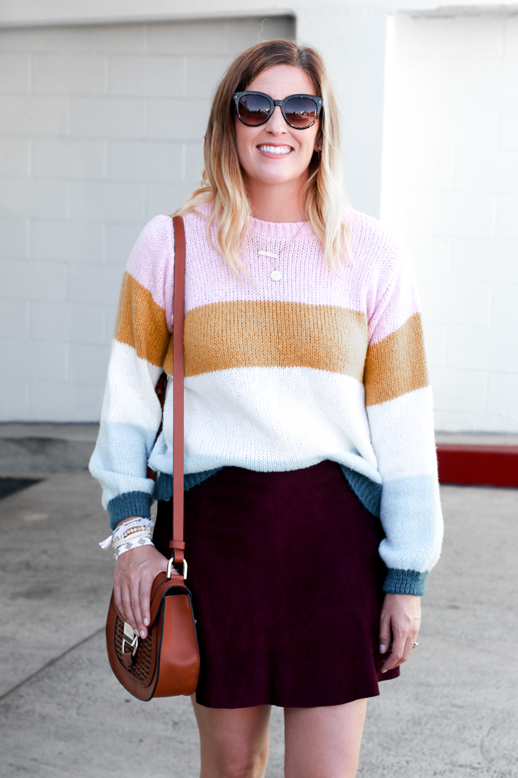 A cute sweater and skirt outfit for fall featured by Popular US Style Blogger, The Fashionista Momma; blonde woman wearing Nordstrom Striped Sweater and Suede Skirt.