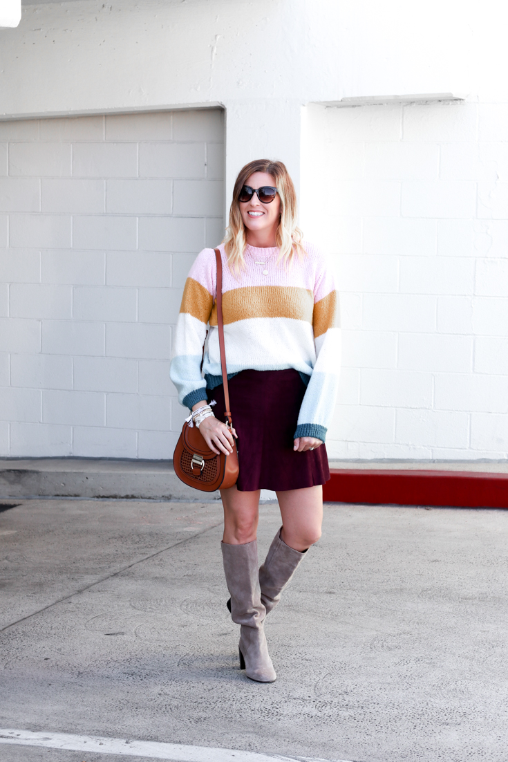 A cute sweater and skirt outfit for fall featured by Popular US Style Blogger, The Fashionista Momma; blonde woman wearing Nordstrom Striped Sweater and Suede Skirt with knee high boots.