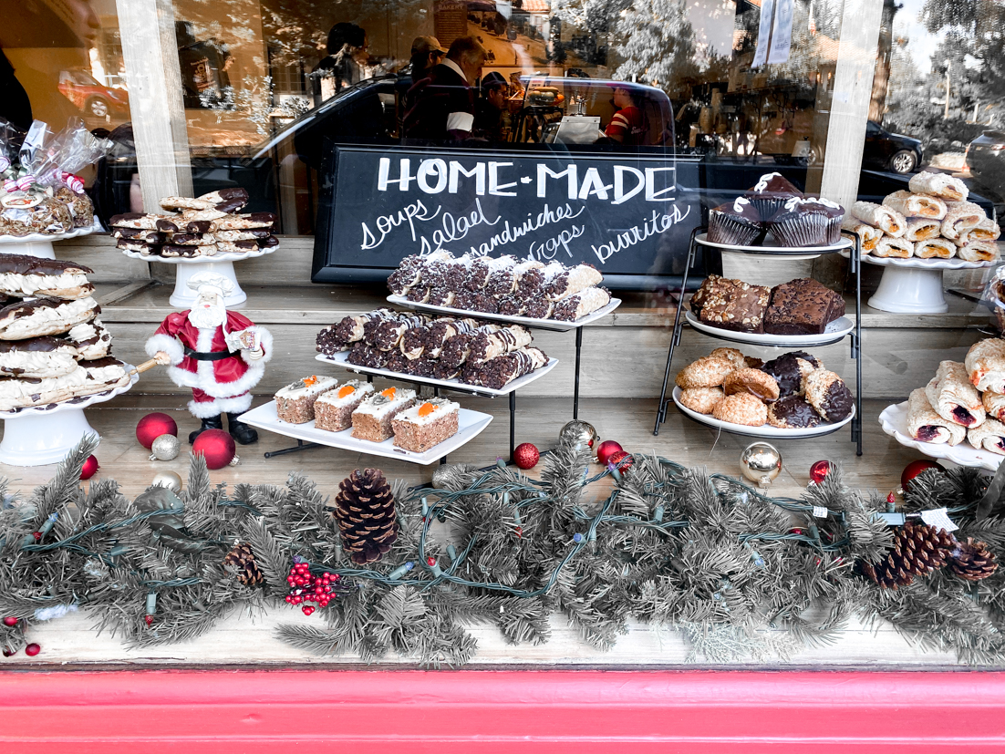 The Ultimate San Diego To San Francisco Road Trip For The Holidays featured by Top Family Travel Blog, The Fashionista Momma; Window Display at Carmel Bakery