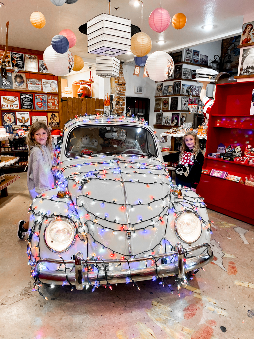 The Ultimate San Diego To San Francisco Road Trip For The Holidays featured by Top Family Travel Blog, The Fashionista Momma; Kids standing in Rocket Fizz in San Luis Obispo