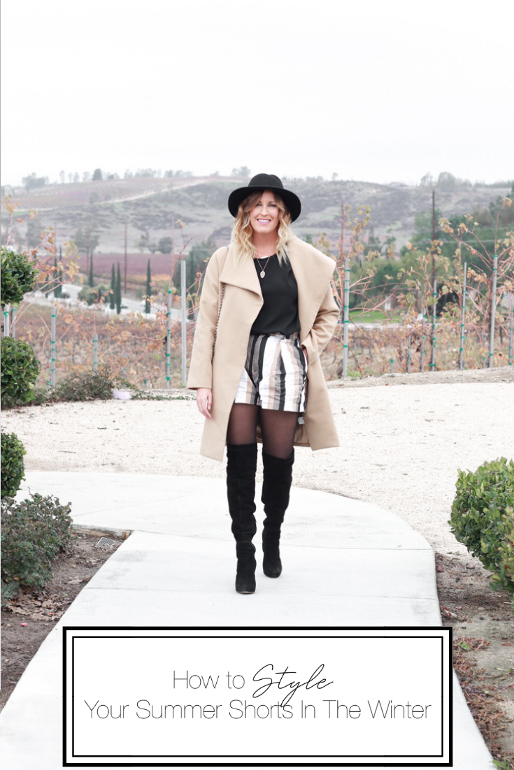 How to Style Your Summer Shorts In The Winter featured by Top US Style Blog, The Fashionista Momma; blonde woman wearing striped shorts, OTK Boots and a camel wool coat.