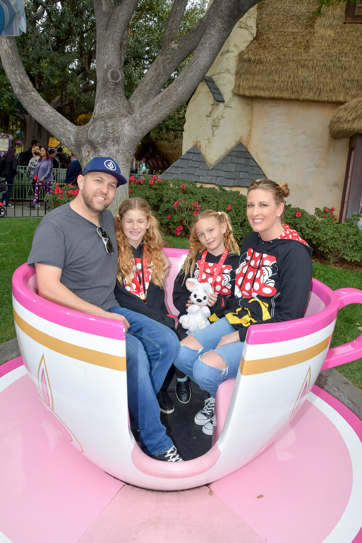 The Ultimate SoCal Staycation featured by Popular US Travel Blog, The Fashionista Momma; family at Disneyland in tea cup
