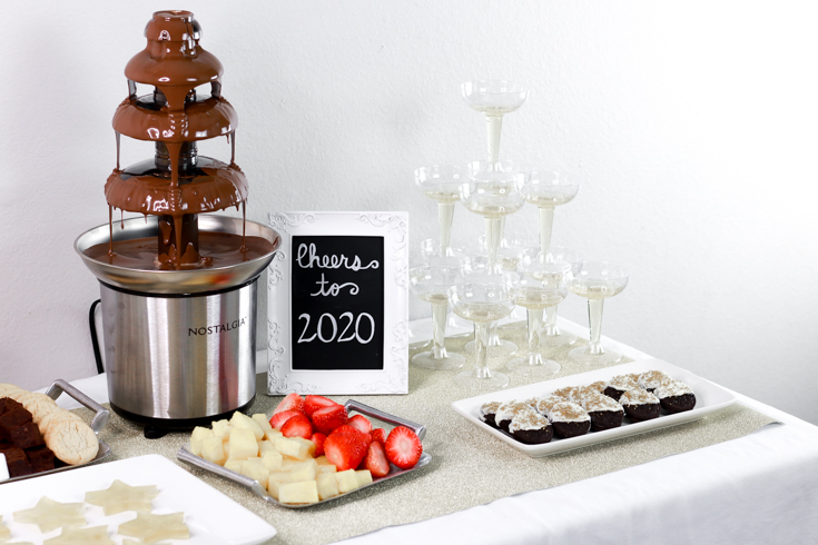 Family Friendly New Years Party featured by popular US Party Blog, The Fashionista Momma; Dessert Table with chocolate fountain.