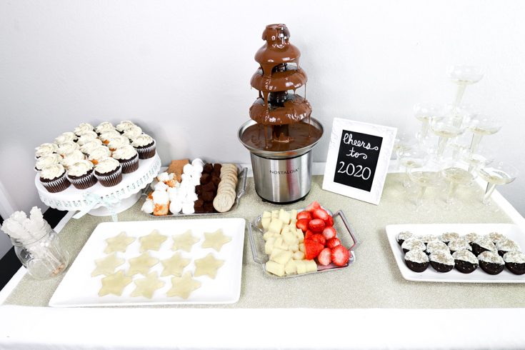 The Ultimate New Years Party featured by popular US Party Blog, The Fashionista Momma; Dessert Table with chocolate fountain.