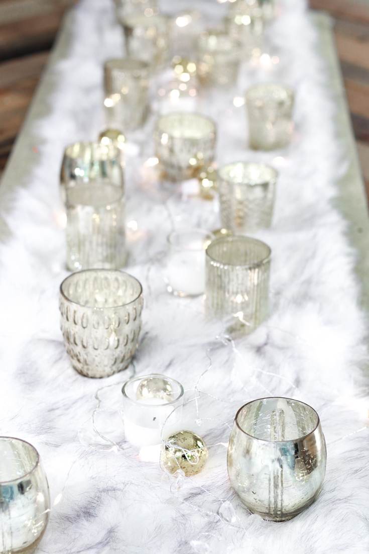 Table Decor featured by popular US Party Blog, The Fashionista Momma; Tablescape with fur table runner. candles and lights.
