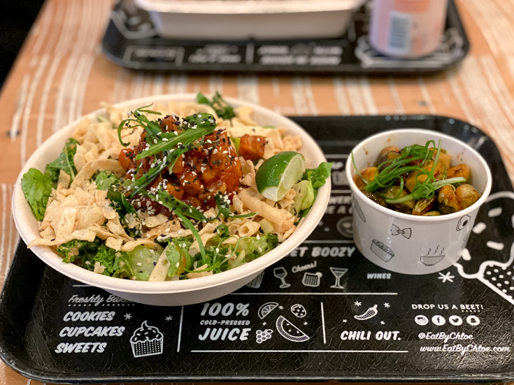 My Favorite Vegan Spots in NYC featured by popular US Travel Blogger, The Fashionista Momma; Salad and Brussel Sprouts from Eat By Chloe.