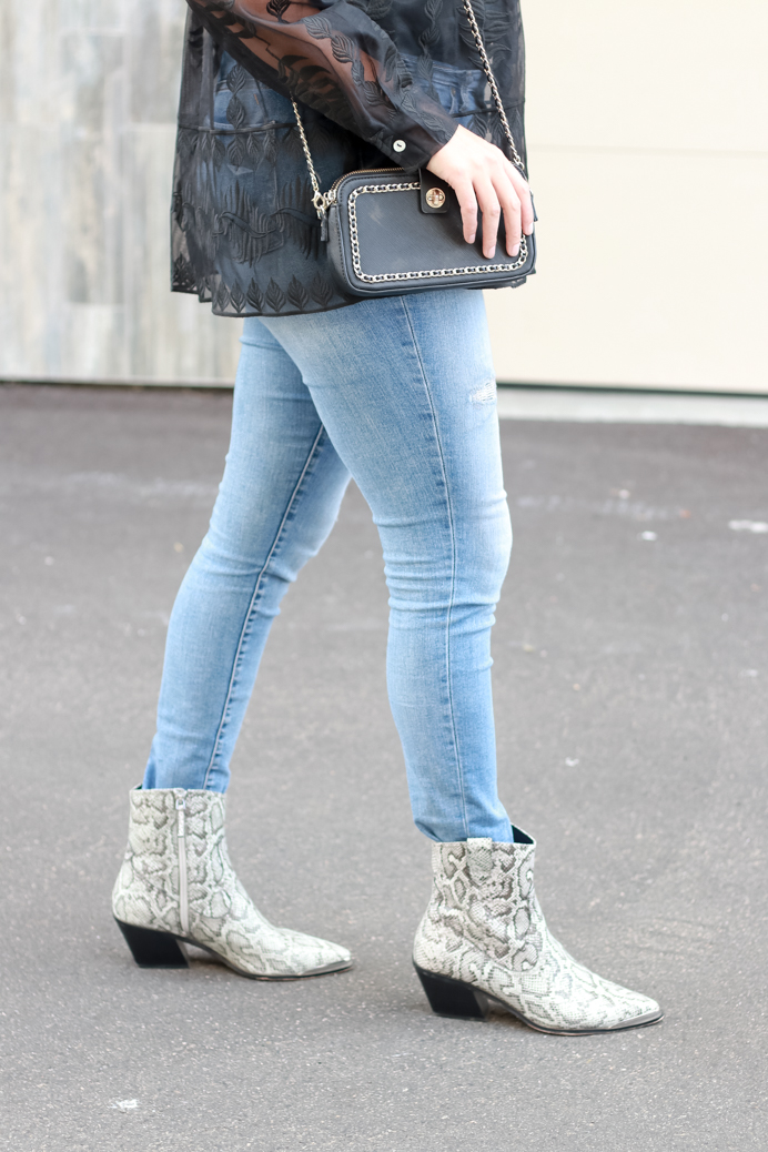 Snakeskin boots and black crossbody bag featured by Popular US Style Blogger, The Fashionista Momma; black crossbody bag