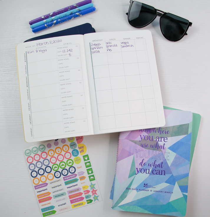 Marathon Training Guide With Erin Condren featured by The Fashionista Momma; flat lay of planner