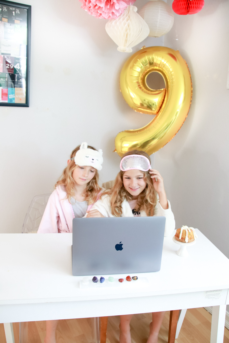 9 Virtual BIrthday Party Ideas featured by Top US Party Blogger, The Fashionista Momma; two girls in spa sets having a virtual birthday.