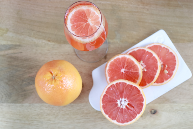 How To Host A Virtual Happy Hour with my a twist on an Aperol Spritz featured by popular US Lifestyle blogger, The Fashionista Momma;  Aperol Spritz with grapefruit