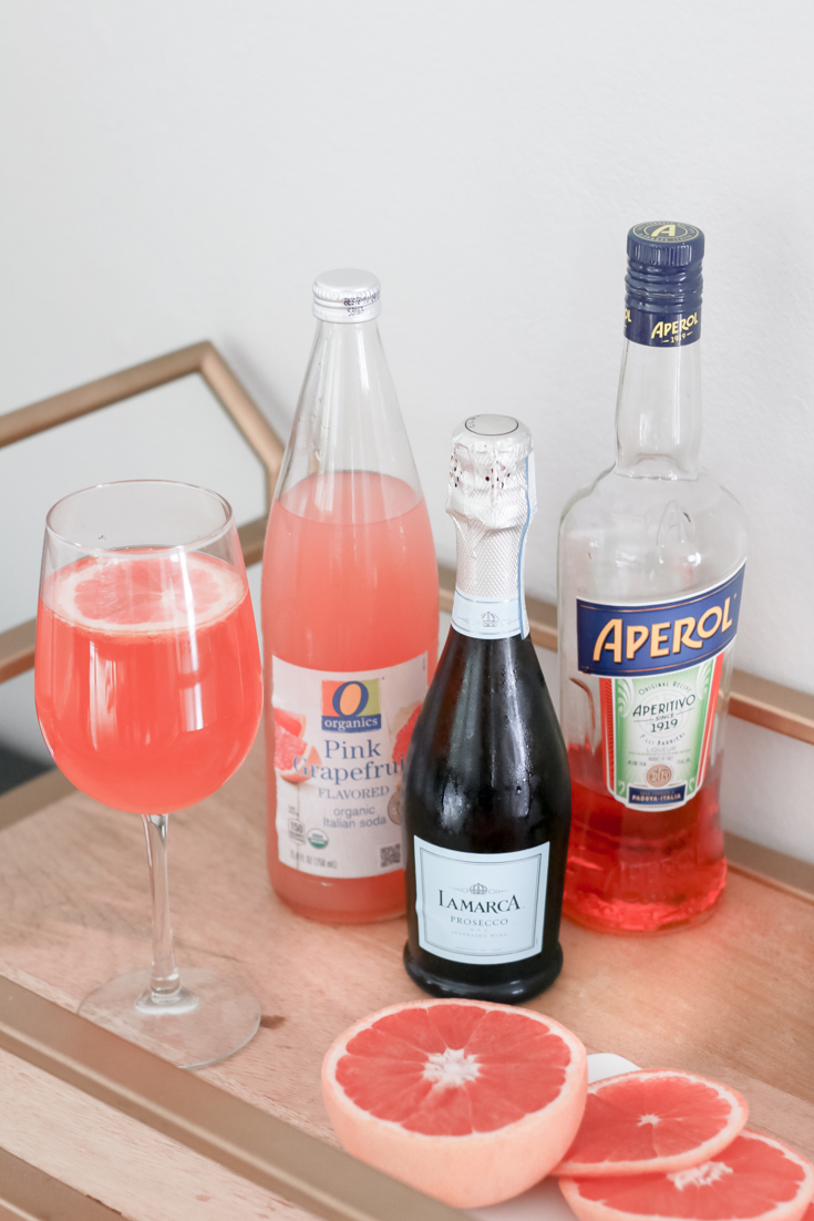 How To Host A Virtual Happy Hour with my a twist on an Aperol Spritz featured by popular US Lifestyle blogger, The Fashionista Momma; Aperol Spritz ingredients