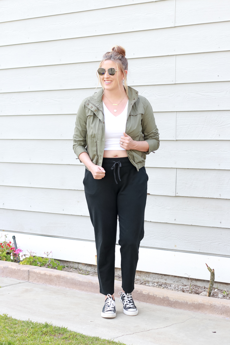 Comfy Casual Joggers featured by popular US Style Blogger, The Fashionista Momma; blonde women wearing black joggers and a crop top.