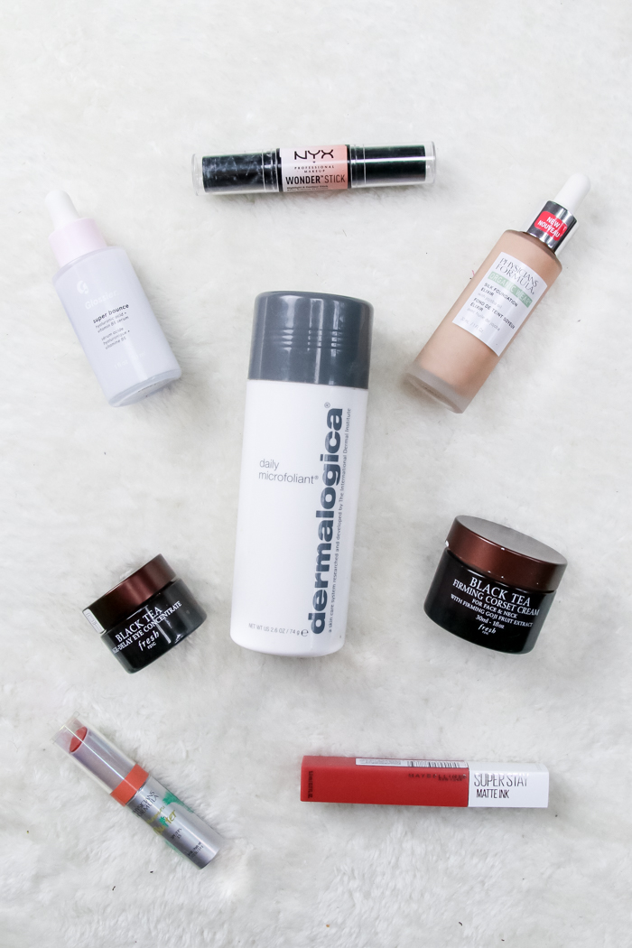 My Fave Beauty Products featured by popular US Beauty Blogger, The Fashionista Momma; Flat Lay of beauty products including Dermalogica, Fresh, Maybelline, Physicians Formula, Glossier, NYX