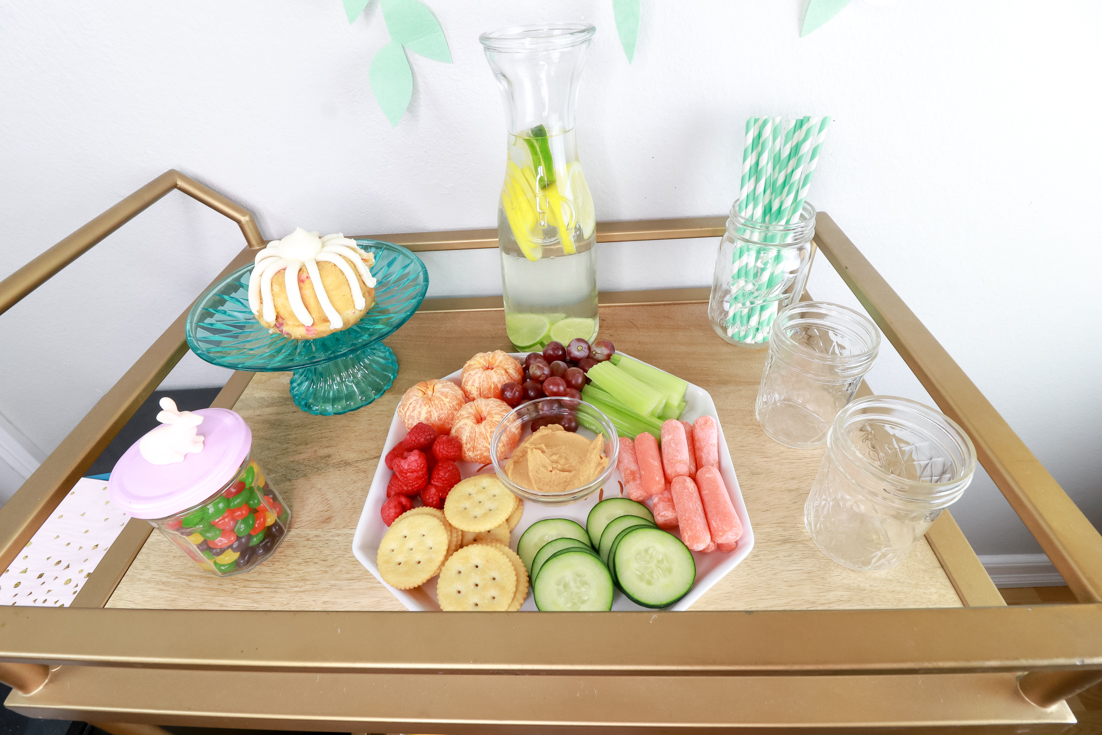 The Ultimate Spa Birthday Party For Kids featured by popular US Party Blog, The Fashionista Momma; Bar Cart setup for a spa party.
