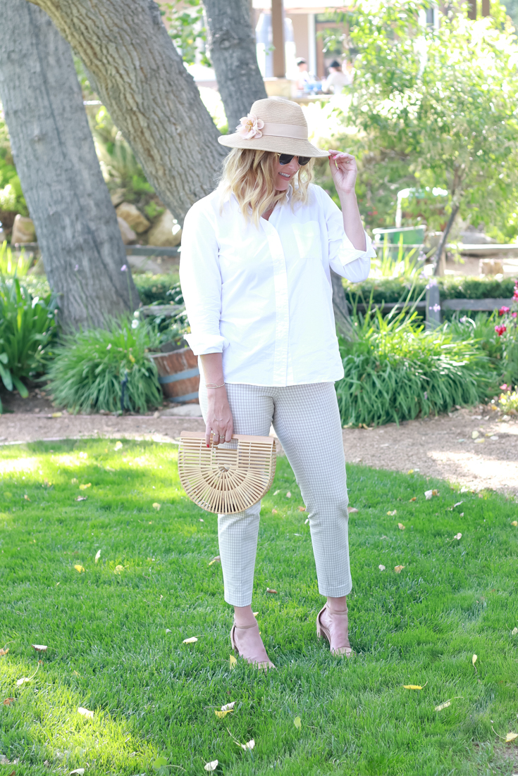 Gingham Plaid Pants featured by Popular US Style Blogger, The Fashionista Momma; woman wearing plaid pants and a white top.