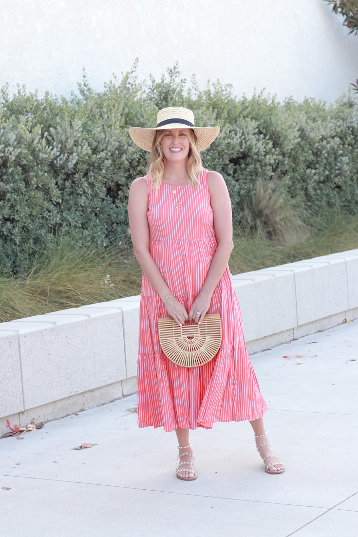 The Perfect Summer Maxi Dress For Under $30 featured by popular US Style Blogger, The Fashionista Momma; woman wearing striped tiered maxi dress