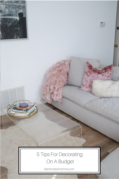 5 Tips To Decorating Your Home On A Budget featured by popular US Home Decor Blogger, The Fashionista Momma; living room furniture with faux fur.