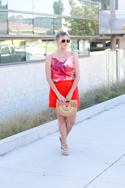 How To Wear Bright Shorts featured by popular US Style Blogger, The Fashionista Momma; woman wearing bright shorts with a printed tank top from Target.