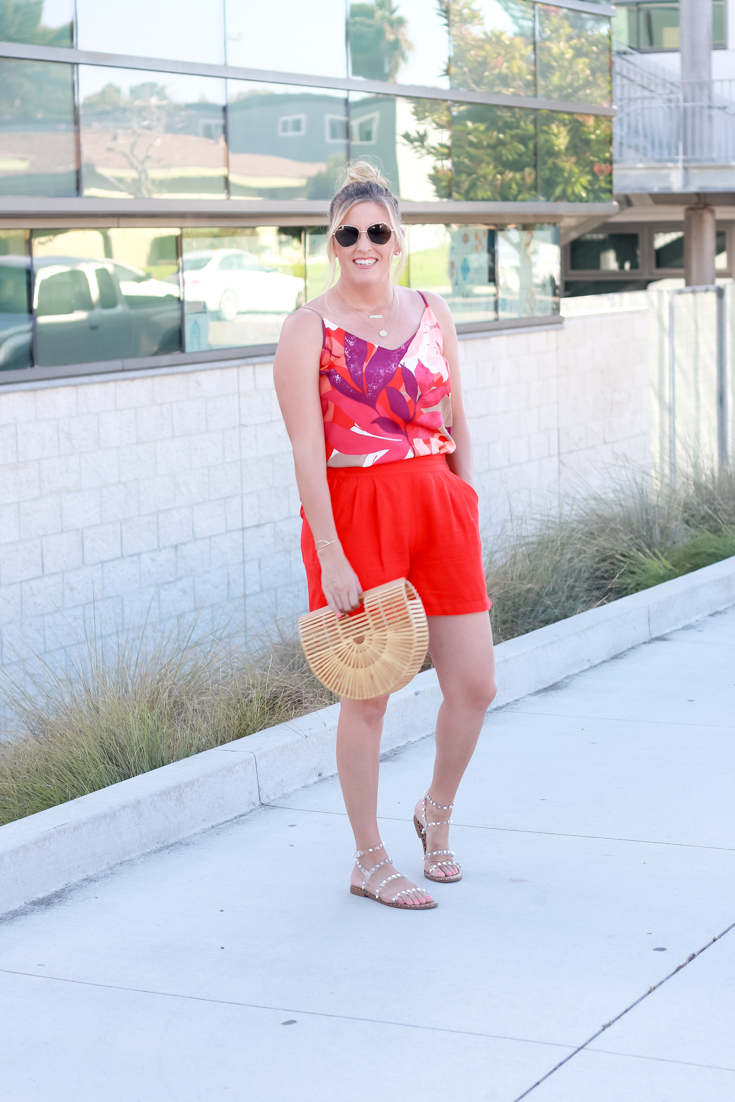 How To Style Bright Shorts featured by popular US Style Blogger, The Fashionista Momma; woman wearing bright shorts with a printed tank top from Target.