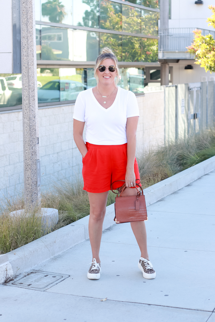 How To Style Bright Shorts featured by popular US Style Blogger, The Fashionista Momma; woman wearing bright shorts with a white tee from Target.