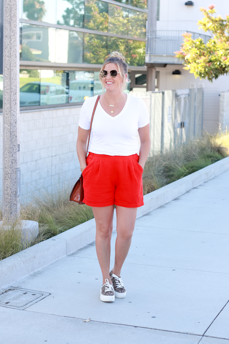 How To Wear Bright Shorts featured by popular US Style Blogger, The Fashionista Momma; woman wearing bright shorts with a white tee from Target.