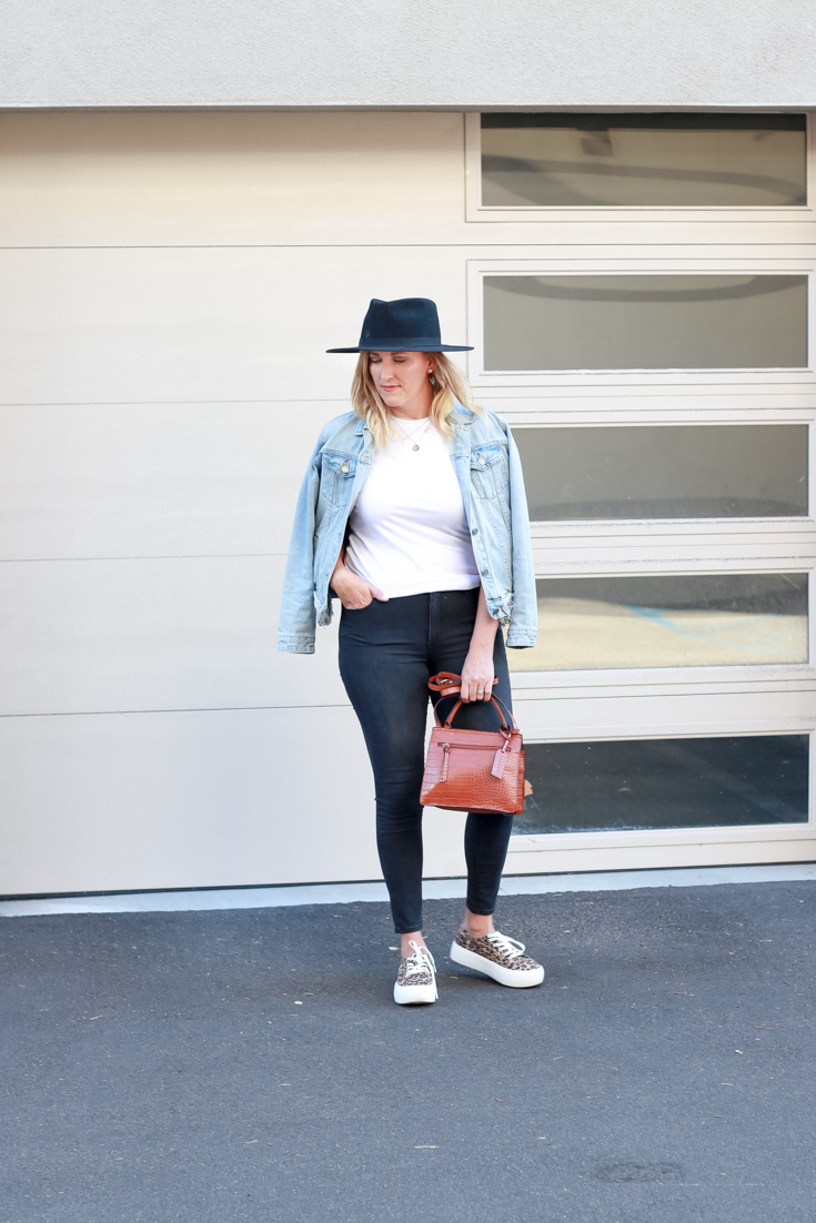 15 Must Have Basics For Your Wardrobe featured by Top US Style Blogger The Fashionista Momma; woman wearing dark grey denim and white tee featuring Mott & Bow.
