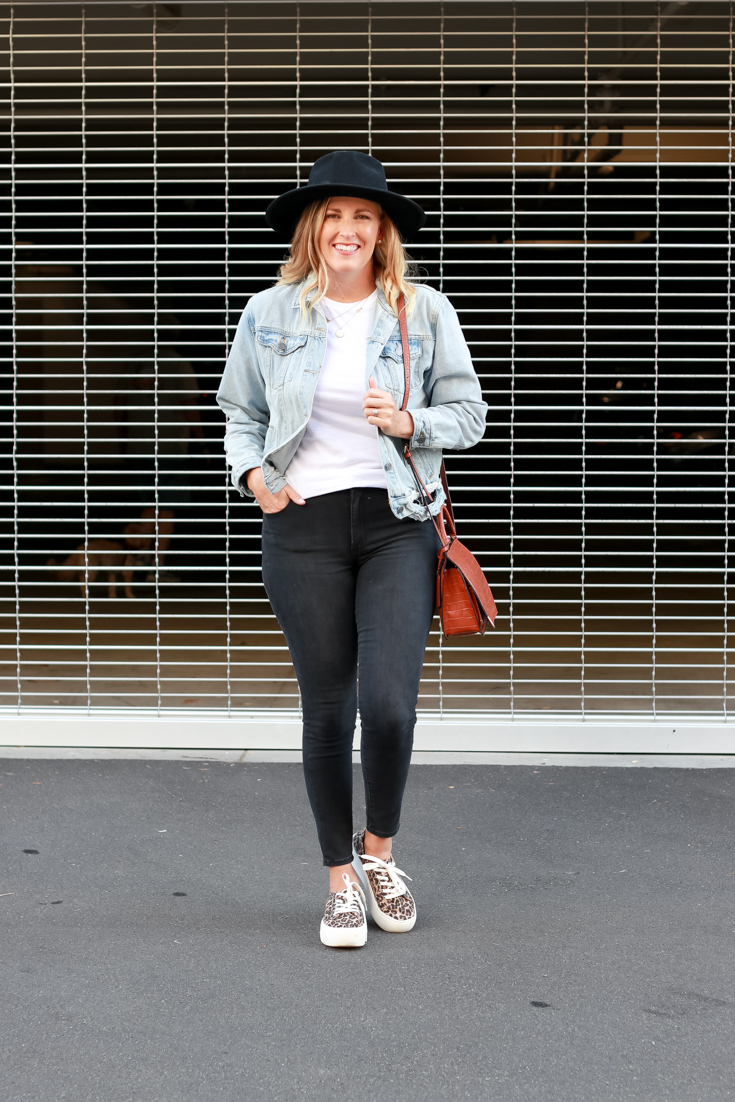15 Must Have Basics For Your Wardrobe featured by Top US Style Blogger The Fashionista Momma; woman wearing black denim and white tee featuring Mott & Bow.