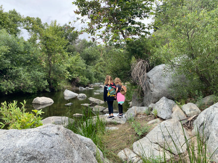 Family Hike To Santa Margarita River Trail featured by popular US family travel blog The Fashionista Momma; small waterfall at Santa Margarita River Trail.