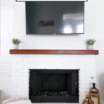 DIY Brick Fireplace featured by popular US Style Blogger, The Fashionista Momma; white brick fireplace.