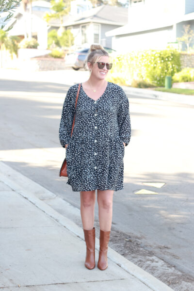 The perfect dark print dress for fall with ONecklace featured by popular US Style Blogger, The Fashionista Momma. woman wearing a dress and boots.