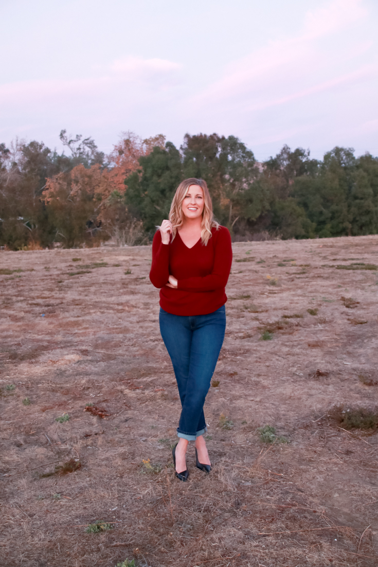 The Perfect Easy Holiday Outfit featured by Popular US Style Blogger, Style And Wanderlust; woman wearing boyfriend jeans and a sweater.